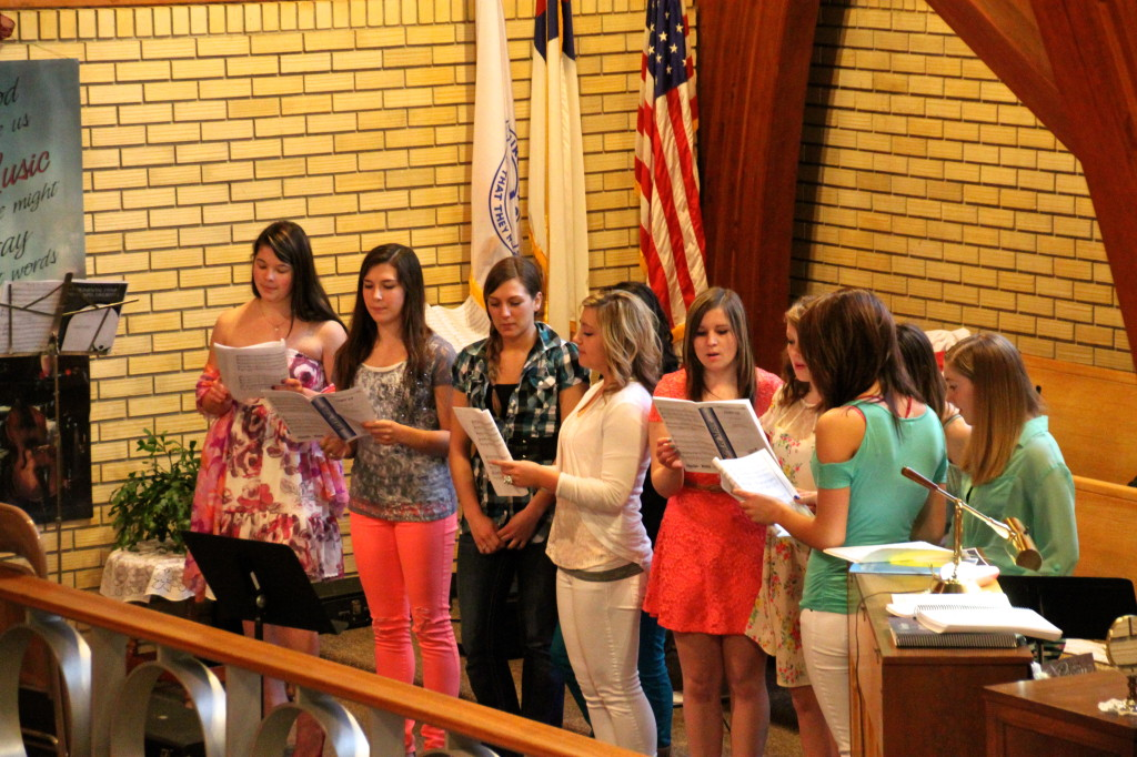 Girls choir singing at community service