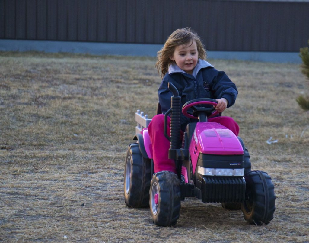 The Pinke Post Riding Pink Tractor