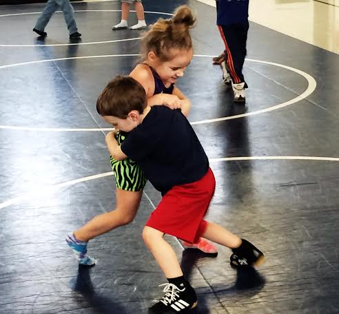 Kids Play Wrestling Pinned Down